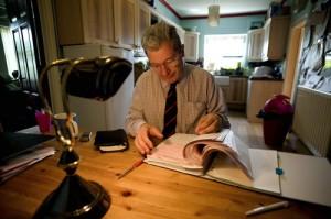 Former maths teacher Paul Buzzard working at home