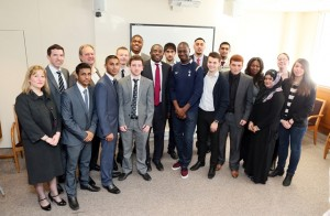 Haroon, centre, with David Lammy MP, former Tottenham footballer, Ledley King, and his fellow apprentices